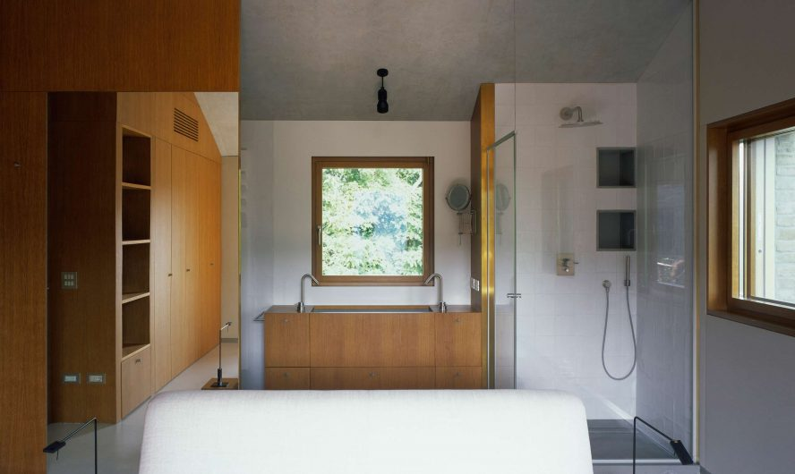 View of the bathroom with single-sash window on the back wall