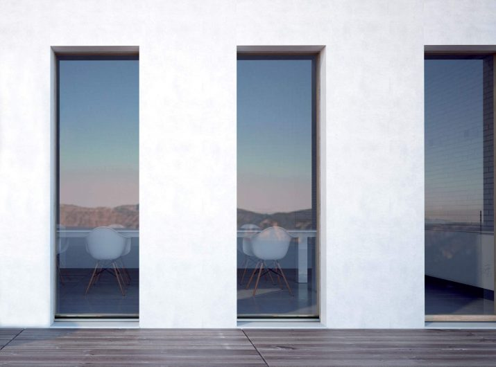 Exterior view of three Skyline patio doors with vitrum effect and structural glass