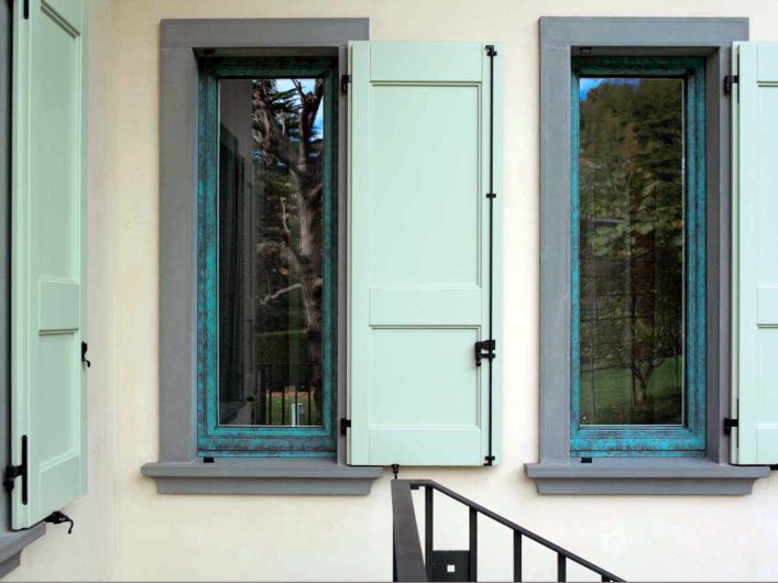 External view of the windows with lacquered wooden shutters