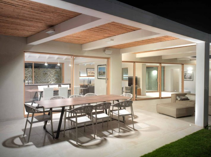 Evening view of the porch with lift and slide doors in oak with two and four doors