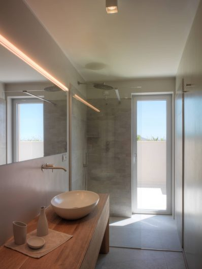 View of the secondary bathroom with aluminum-clad French door