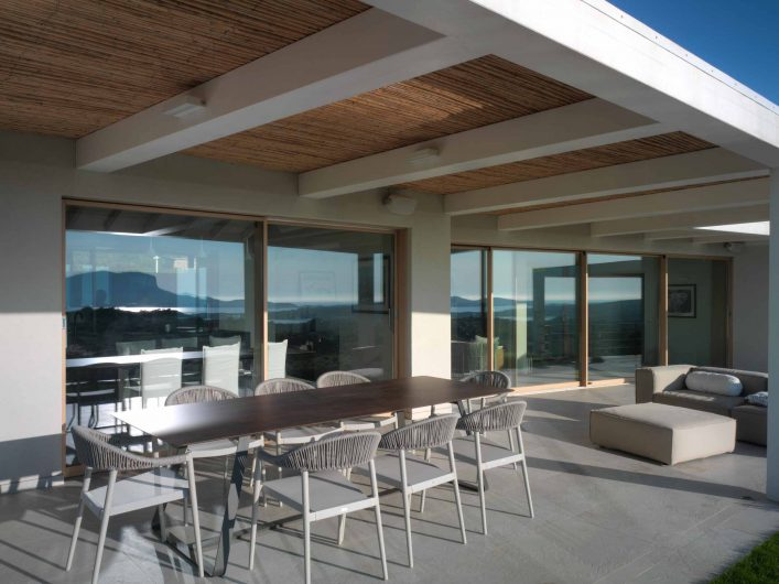View of the porch at sunset with lift and slide doors in natural effect oak
