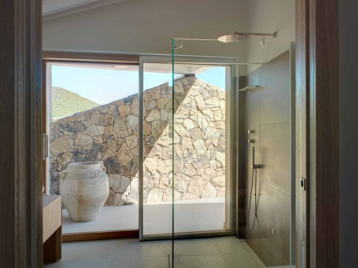 View of the bathroom with sliding shower lift, lined with aluminum