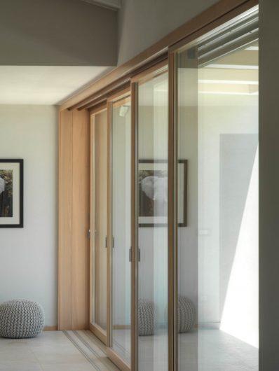 Detail of the closed four-door wooden sliding door