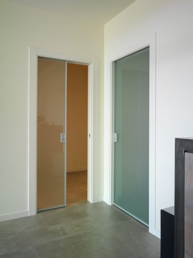 View of two internal sliding doors in aluminum and glass