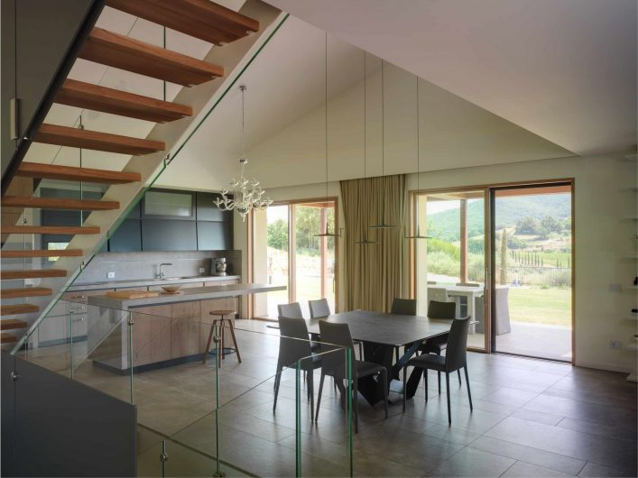 View of the open space with lift and slide doors in oak with a natural finish
