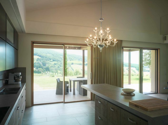 View of the lift and sliding door with two doors in the kitchen area of Villa Pisa