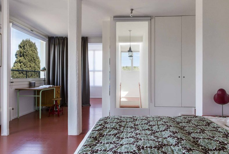 View of the bedroom with a white lacquered transom window