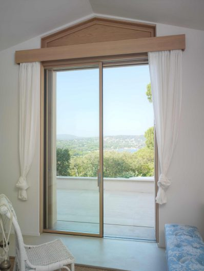 View of the lift and slide with single door hidden in the wall with valance cover and wooden profiles