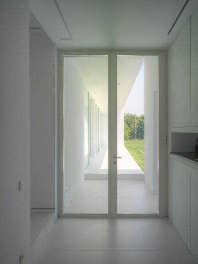 Interior view of the entrance door with two white lacquered doors