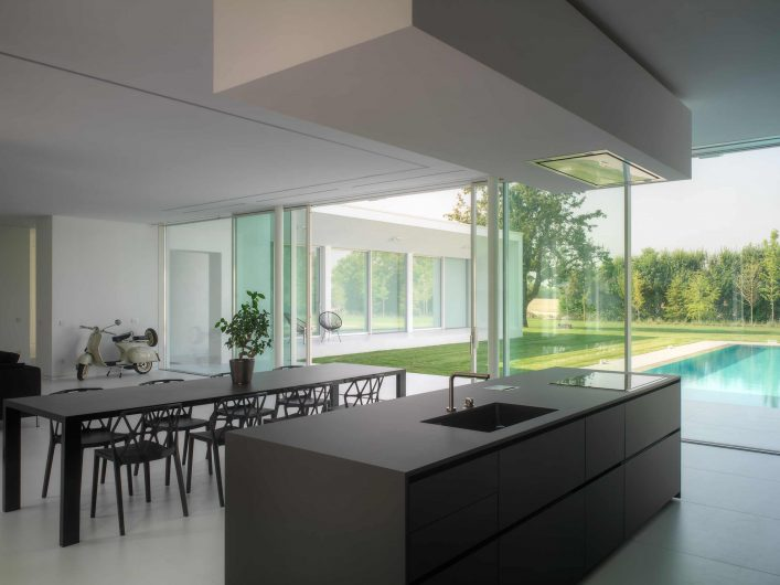 View of the kitchen area with four-door lift and slide in the background