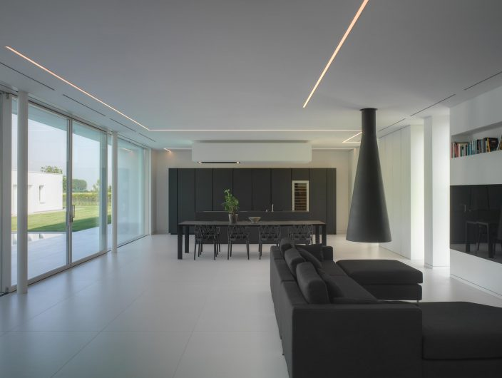 View of the open space of Villa Verona with lift and slide with four doors