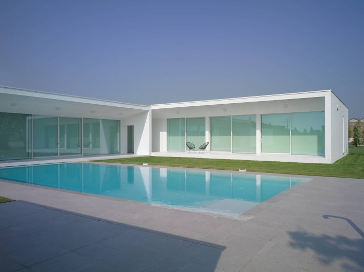 View of the main façade of Villa Verona with lift and slide glass walls and lowered blackout curtains