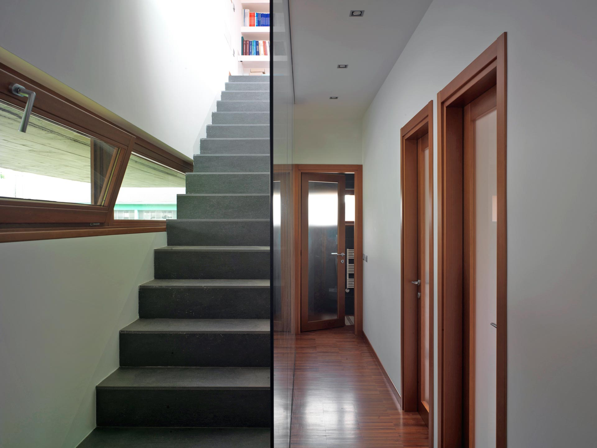 View of a corridor and a staircase with ribbon bottom hung windows