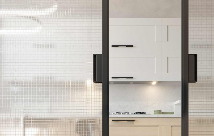 Detail of a two-leaf sliding door with dark gray aluminum handles